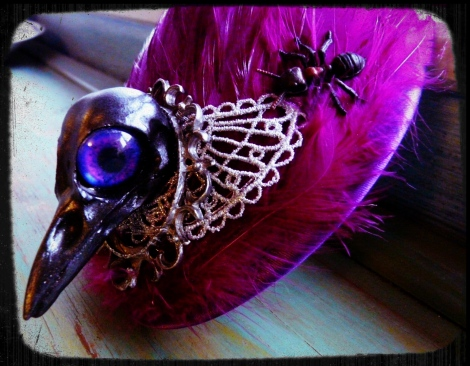 Pink bird fascinator with matching pink/purple eyes.
